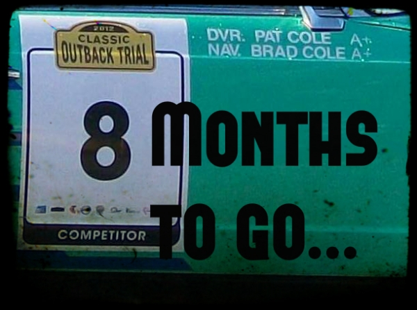 8 months to go written on a rally car door