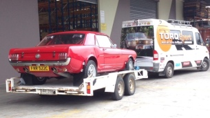 The mustang behind the Swans' service truck.