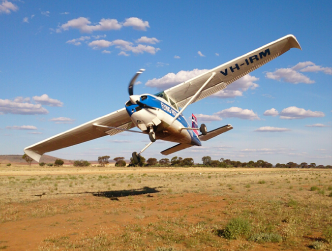 Flying Padre's plane taking off from a station airstrip.