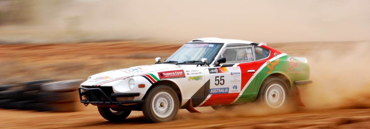 A Datsun 240Z rallying near Alice Springs