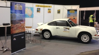 A white Porsche rally car by Tuthill Porsche on the COT stand at Race Retro
