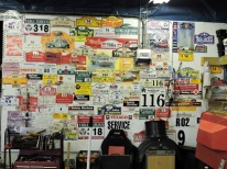 A collection of rally decals on David and Sarah Rayner's wall.