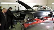 Car on a hoist at Tuthill Porsche