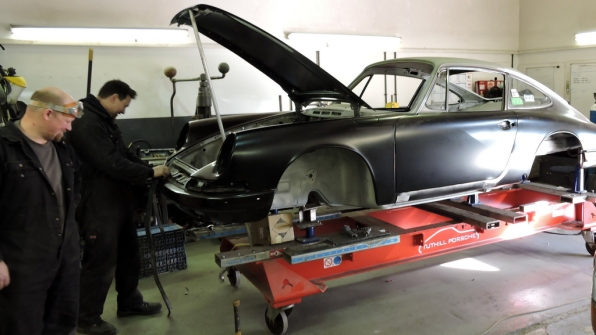 Car on a hoist at Tuthill Porsche