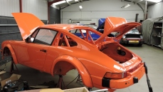 A Porsche being prepared at Tuthill Porsche