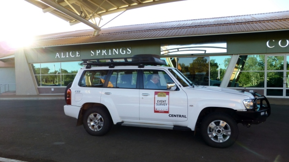 The survey vehicle parked under the portico.