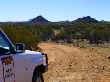 View of distant ranges, with survey car in front.