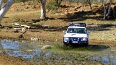 Survey car driving through a spring