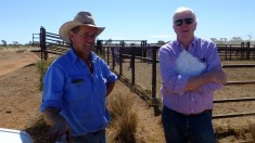 Pic of Andy and Phil in front of the cattle yards
