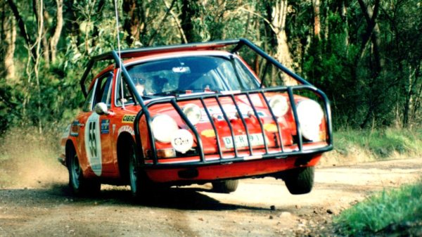 Three-wheeling in the ex London to Sydney Porsche.