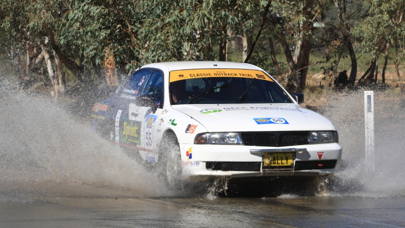 Chris and Blake McCormack crossing a flooded Todd River in COT16. Pic by Phil Williams
